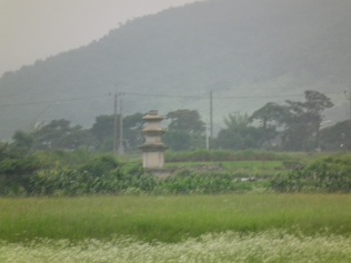 A pagoda in the distance is a sign of devotion, but can't express what once stood here.