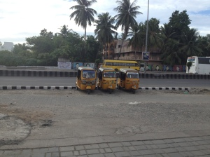 auto-rickshaws waiting outside my building